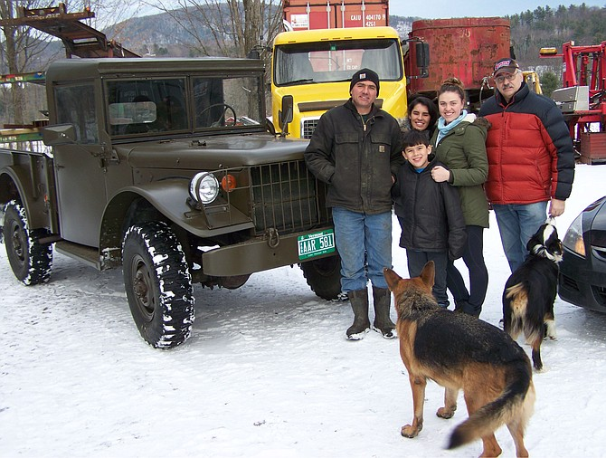 """Keith Mazzaroni of Pittsford (left), with family and friends (and dogs), is the proud owner of a """"new"""" 1951 Korean War-era Dodge M37 3/4-ton, 4X4 six-cylinder cargo truck"""