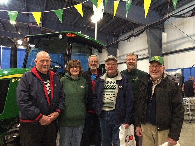Pictured are some staffers of Mountain View Equipment of Middlebury and Rutland, along with customers and visitors at the business's booth at the Vermont Farm Show which concluded last week. Mountain View sponsored a special fundraising drive for the Vermont Foodbank and successfully raised $512.90 thanks to generous customers and friends. (Photo by Bethany Sargent)