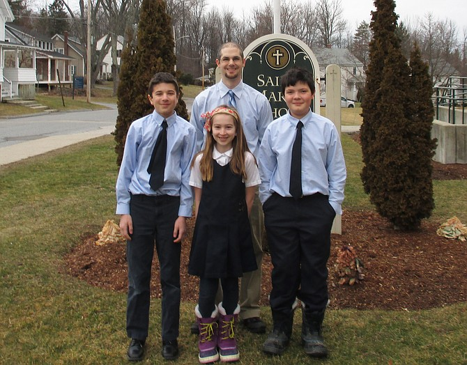 St. Mary's School top spellers are Liam Wagner, Thomas Wolosinski, and Maggie Lane, with Interim Principal Craig Hill. Wagner moves on to statewide competition.